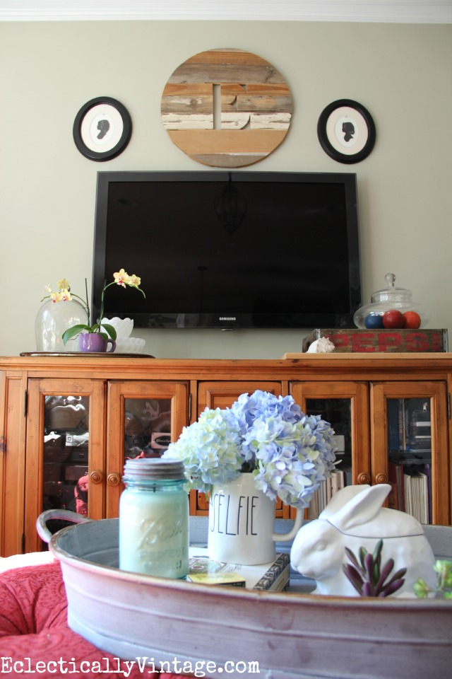Love this cozy family room and the rustic wood monogram over the tv eclecticallyvintage.com