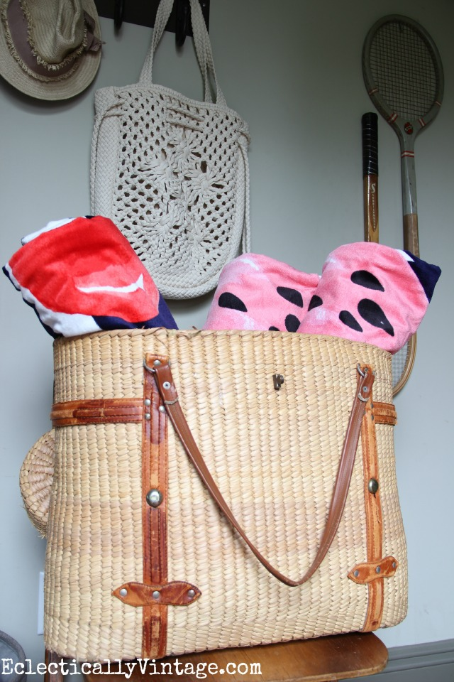 Love this vintage basket to hold beach towels kellyelko.com