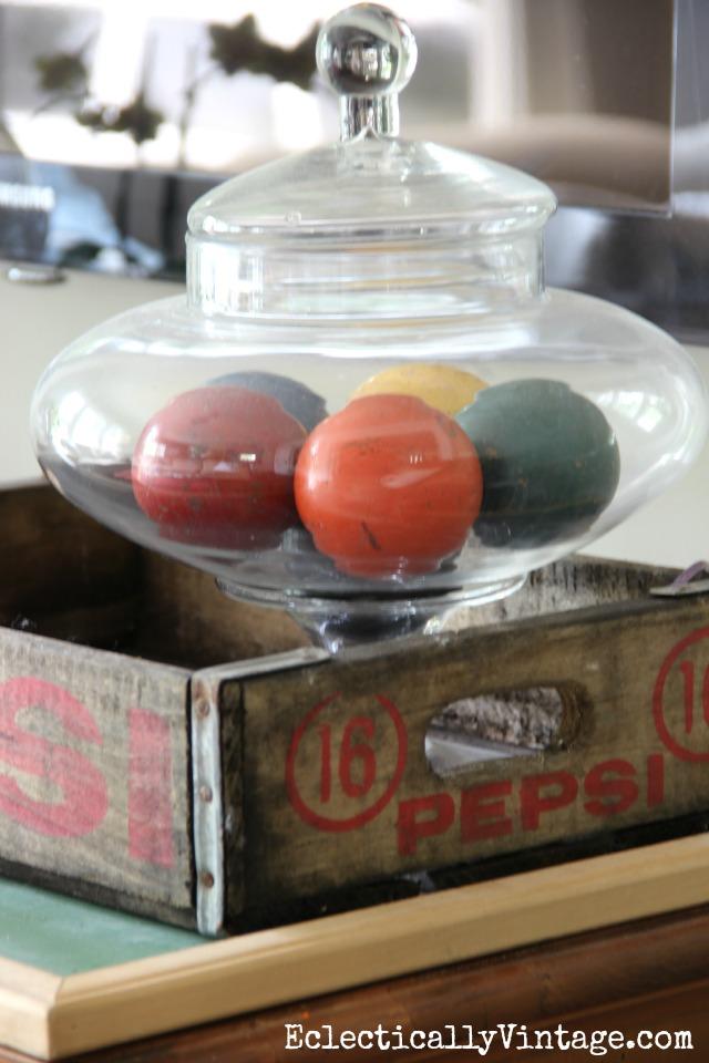Vintage croquet balls displayed in a glass jar eclecticallyvintage.com