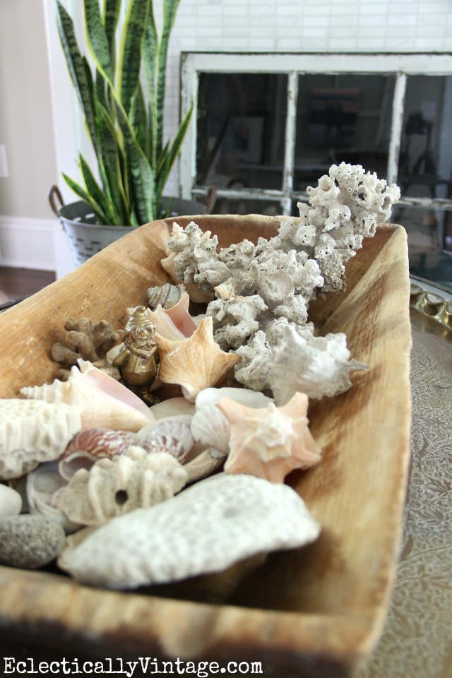 Love this huge old dough bowl filled with shells eclecticallyvintage.com