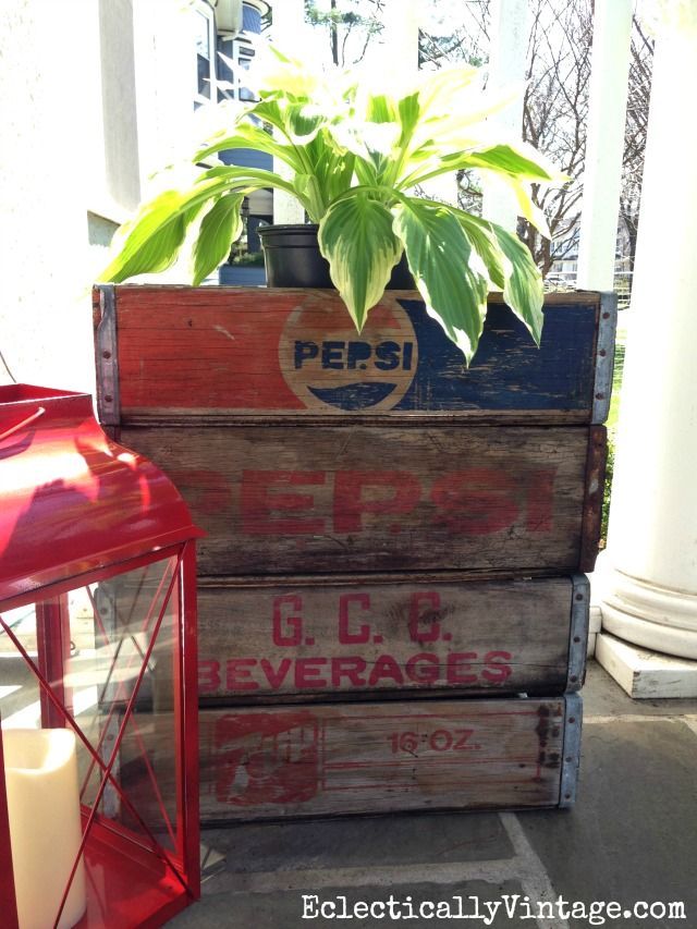 Love these vintage wood soda crates stacked on the front porch and holding plants kellyelko.com