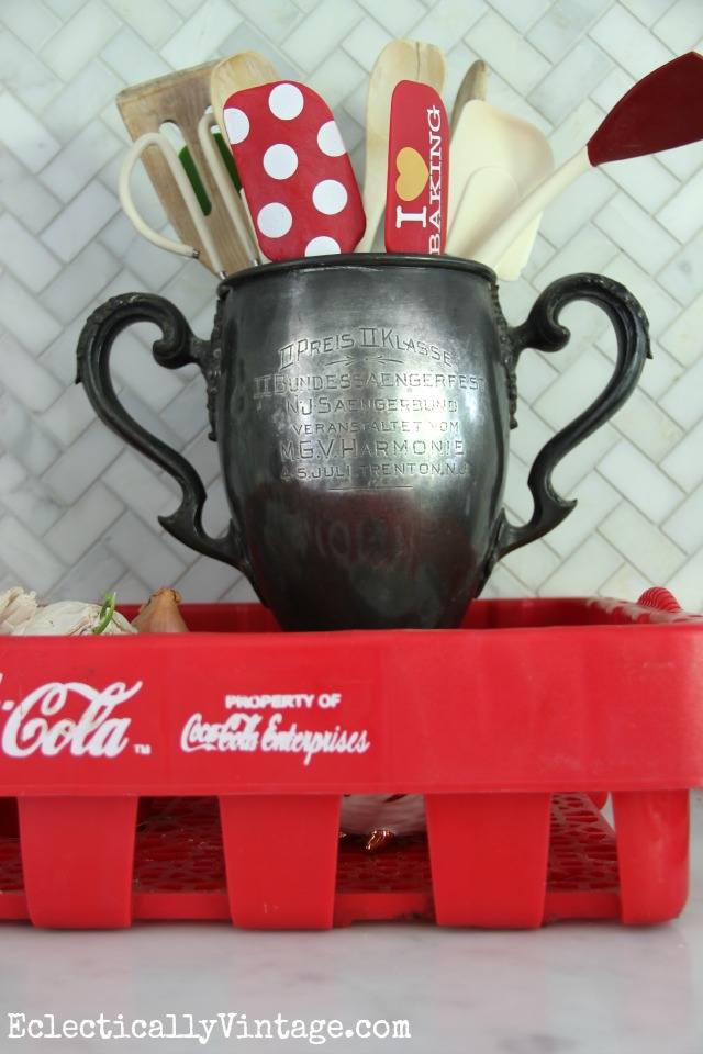 Love this vintage trophy used as a utensil holder kellyelko.com