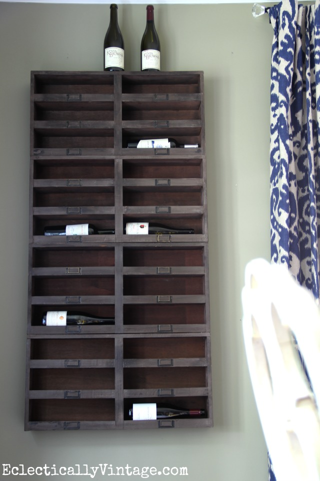 Love this wall of wine cubbies in this completely amazing dining room kellyelko.com