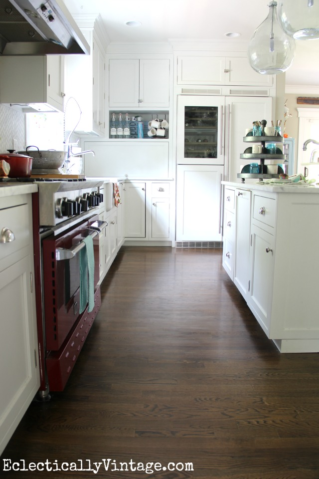 Love this white farmhouse kitchen with great attention to detail - the wine refrigerator is beautiful! kellyelko.com