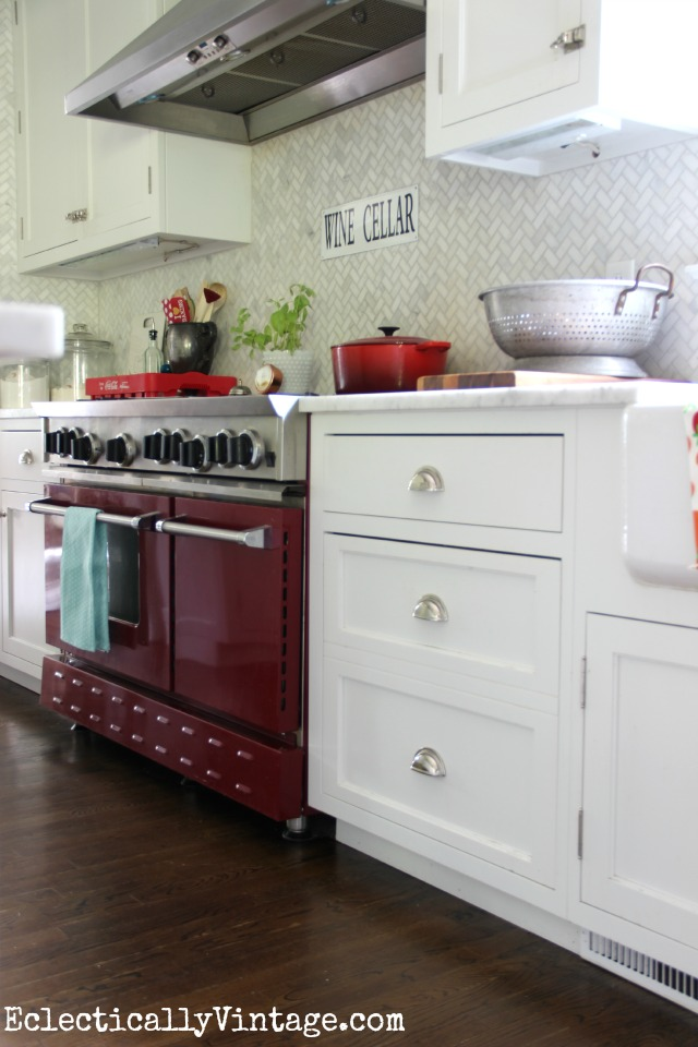 The red stove is the star of this white kitchen! kellyelko.com