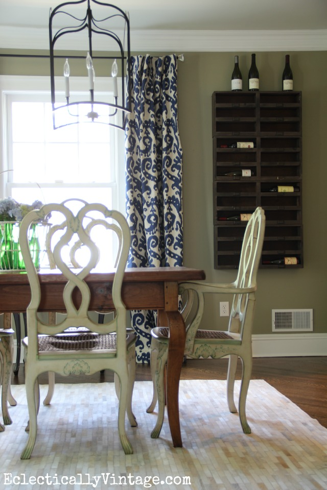 This dining room is stunning! Love the wine cubbies on the wall, the double lanterns and the farmhouse furniture kellyelko.com