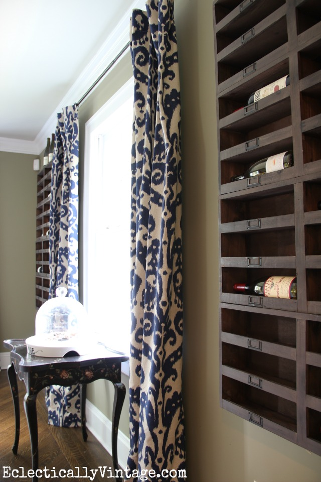 Love this wall of wine cubbies in this rustic dining room kellyelko.com