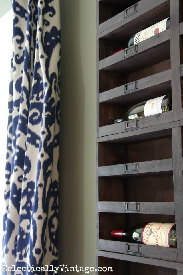Love these rustic wood wine cubbies - they look amazing filling the walls of this dining room kellyelko.com
