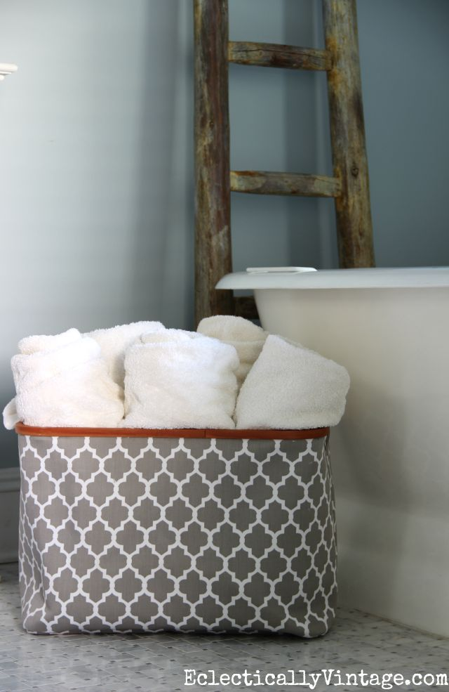 Love this storage idea - a big basket filled with bath towels kellyelko.com