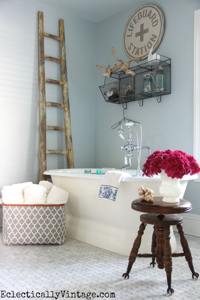 Love the details in this master bathroom - the carrara marble floors and the free standing bathtub kellyelko.com