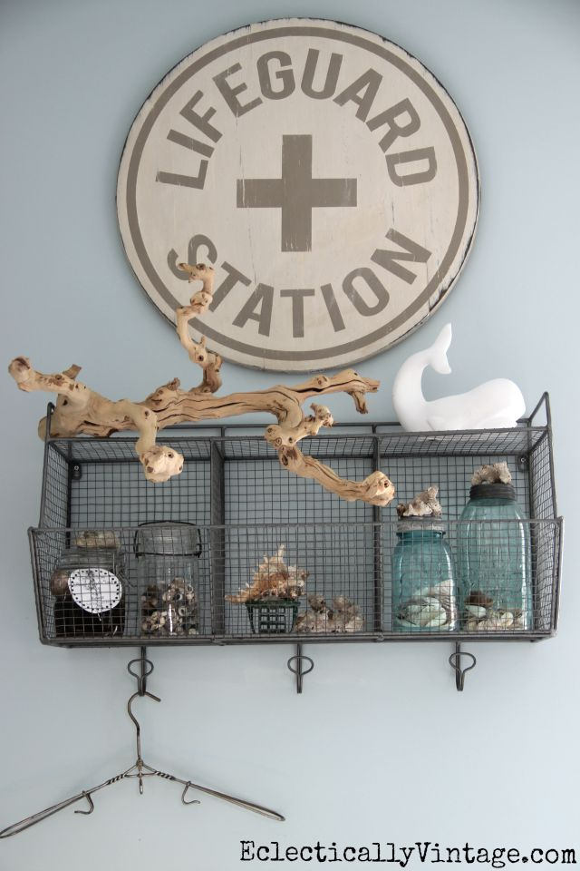 Love this Lifeguard Station sign in the bathroom and all of her coastal accessories kellyelko.com