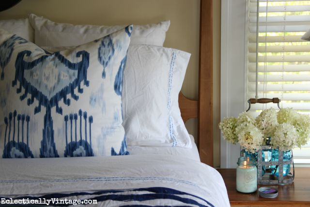 Love this blue and white bedding - the ikat pillow and the striped quilt kellyelko.com