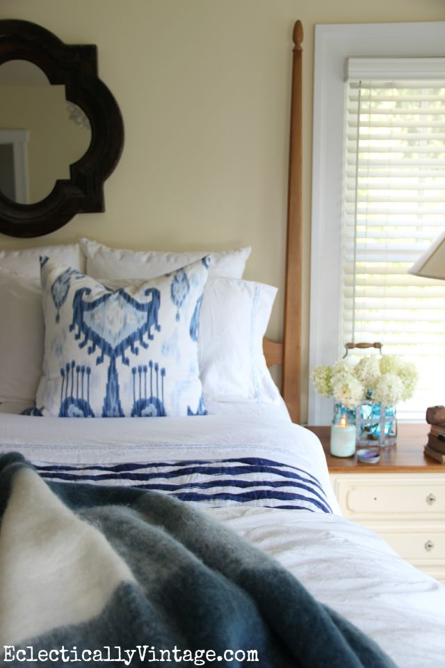Love the mix of patterns in this blue and white bedding kellyelko.com