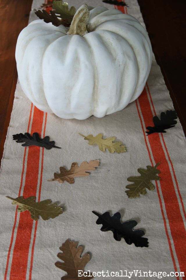 Love this fall centerpiece - she made these DIY embossed metal leaves and it seems so easy! kellyelko.com