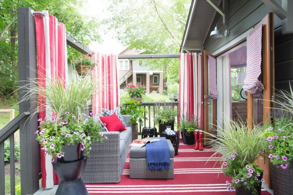 Outdoor deck - love the red striped curtains and rug kellyelko.com