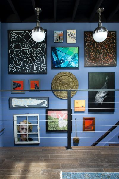 Staircase gallery wall - love the blue walls kellyelko.com