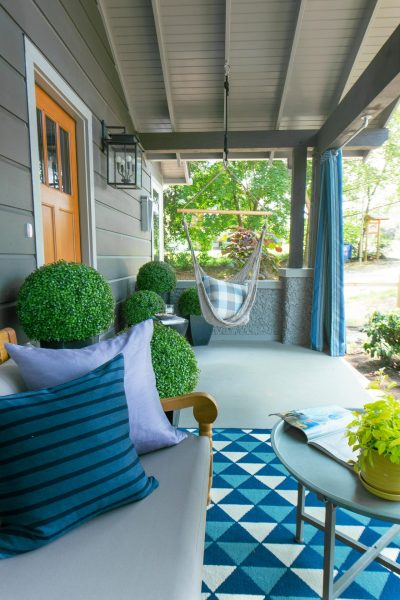 Cottage front porch - love the topiaries and the swing kellyelko.com