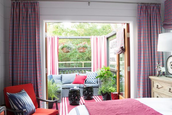 Country bedroom in blue and red - love the french doors leading to the deck kellyelko.com