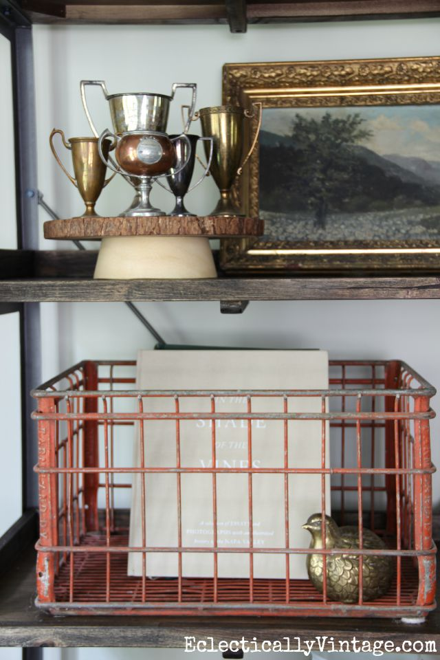 Love the artful arrangements on this open shelving and that vintage red crate kellyelko.com