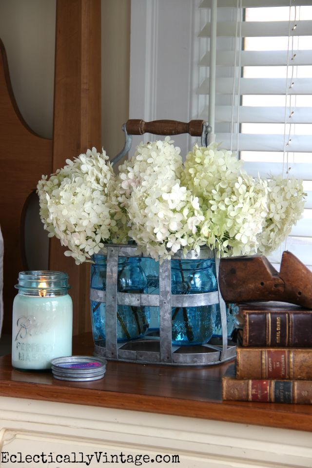 Love this bottle carrier filled with mason jars and white hydrangeas kellyelko.com