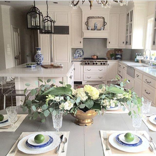 Gorgeous white kitchen - love the table set for dinner kellyelko.com