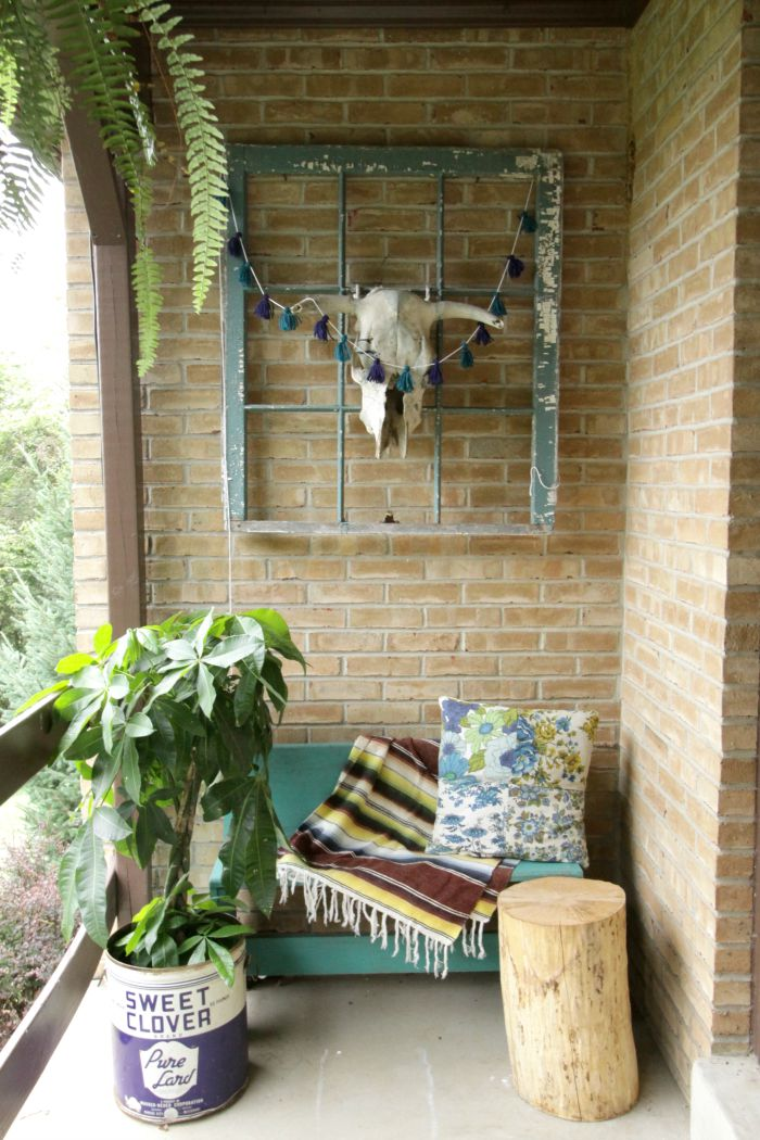 Love this boho porch and that cute tin planter kellyelko.com