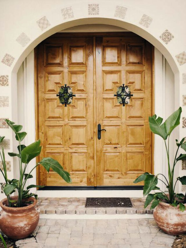 Love the Spanish influence in this house remodel and the double wood carved front doors with tile inlaid in the stucco kellyelko.com