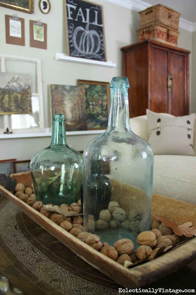 Love this vintage dough bowl filled with old glass bottles and look at that gallery wall! kellyelko.com