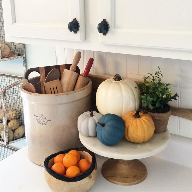 Fall kitchen - love the old crock filled with rolling pins and the pumpkins on a cake stand kellyelko.com