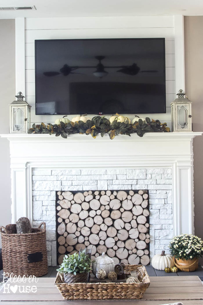 DIY faux mantel with log filled fireplace