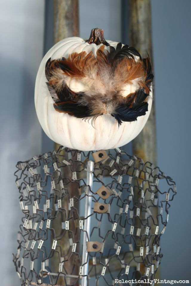 See how to make this Halloween pumpkin head feather mask - so fun on a vintage dress form kellyelko.com