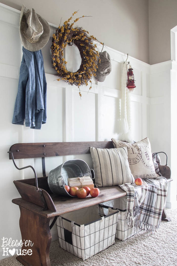 Love this foyer and the rustic bench