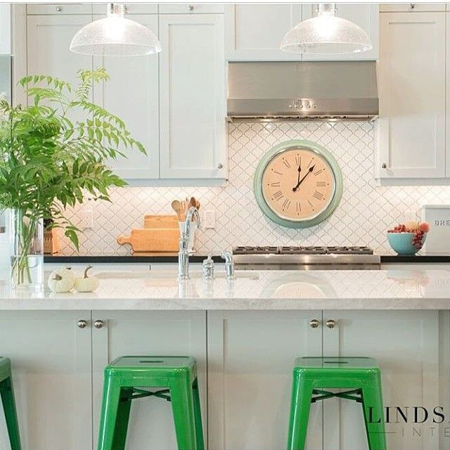 Love a white kitchen with a pop of fun color - the green barstools are such a great choice kellyelko.com