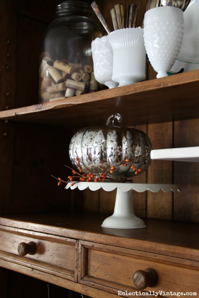 Mercury glass pumpkin looks cute in a dining room hutch kellyelko.com