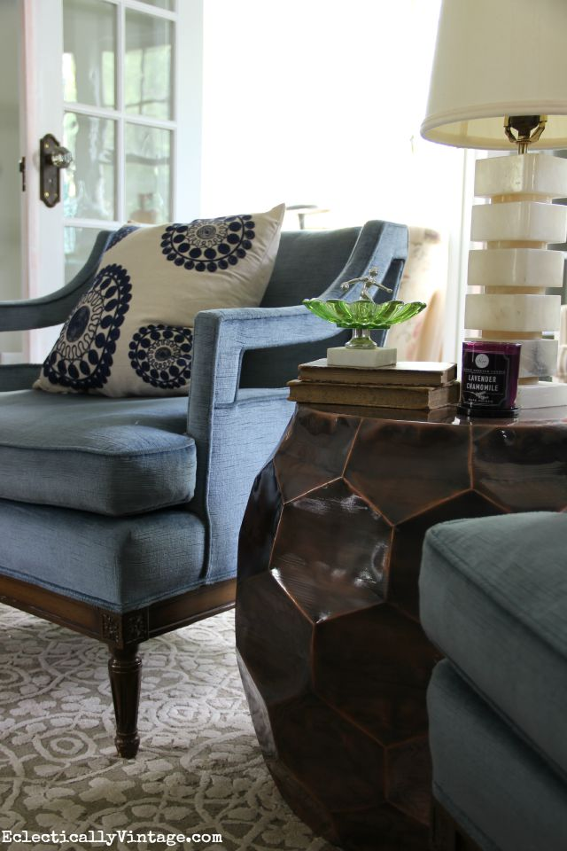 Love these blue mid century club chairs and that bronze accent table kellyelko.com