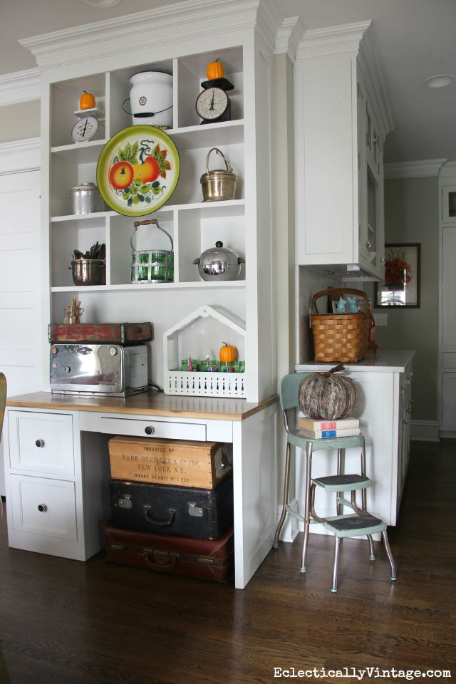 Open shelf styling for fall - love the vintage platter hung in front kellyelko.com