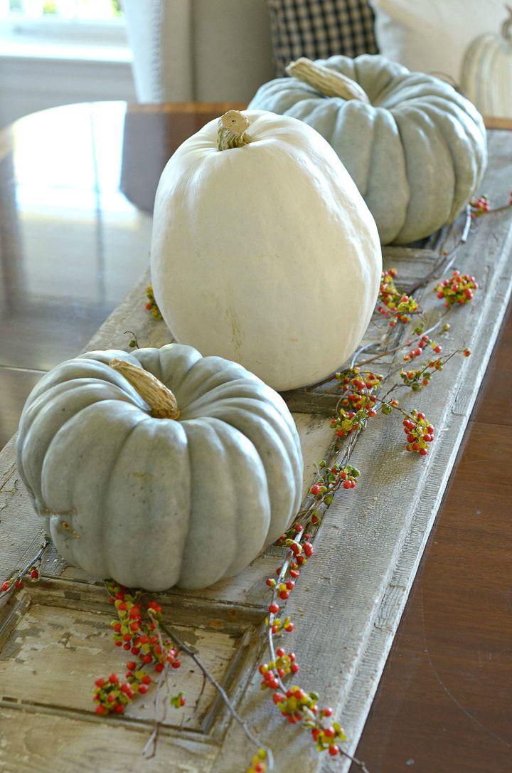 Such creative pumpkin decorating ideas - love this pumpkin centerpiece
