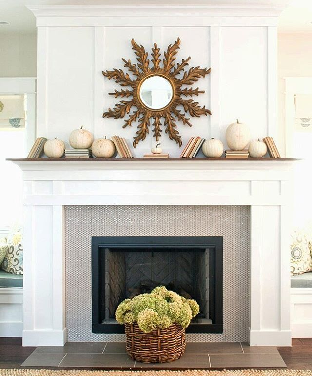 Love this whimsical mantel of white pumpkins and stacked books kellyelko.com