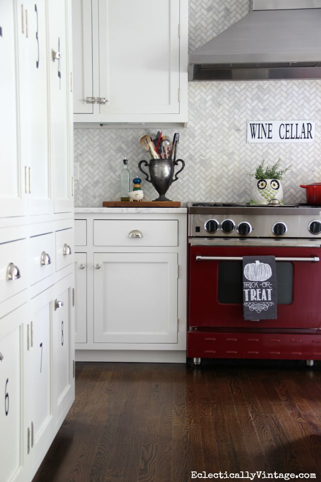 Red stove in a white kitchen - love the herringbone backsplash kellyelko.com