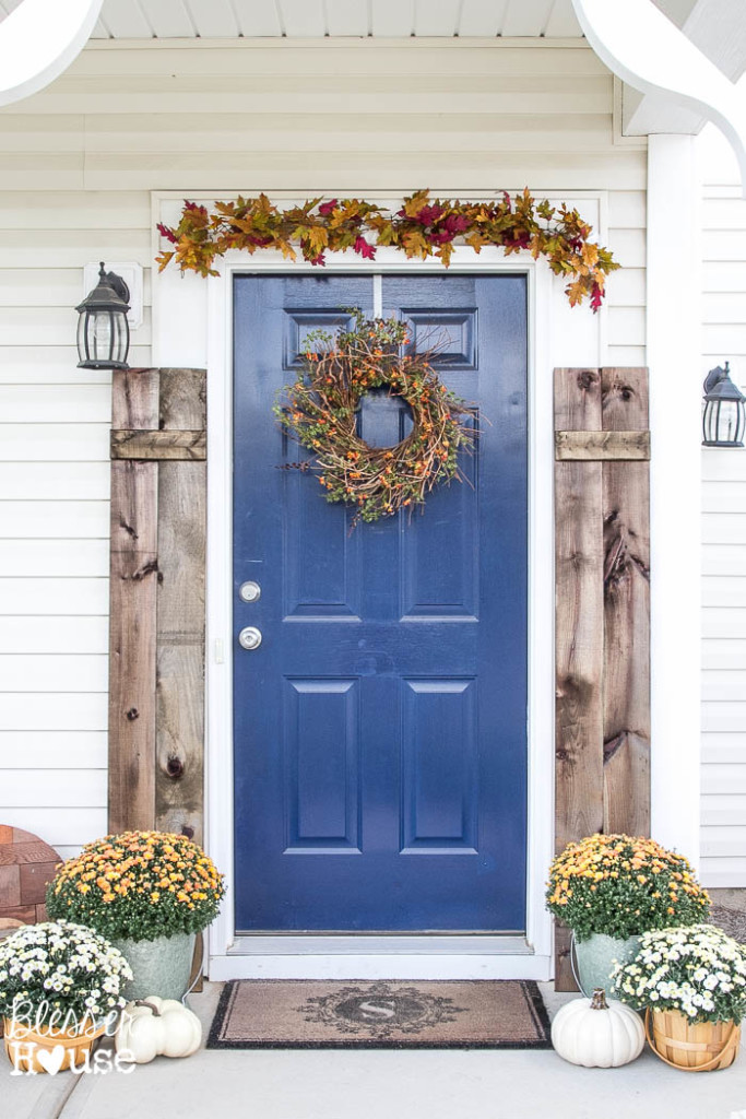 Rustic fall porch - love the blue front door and the shutters