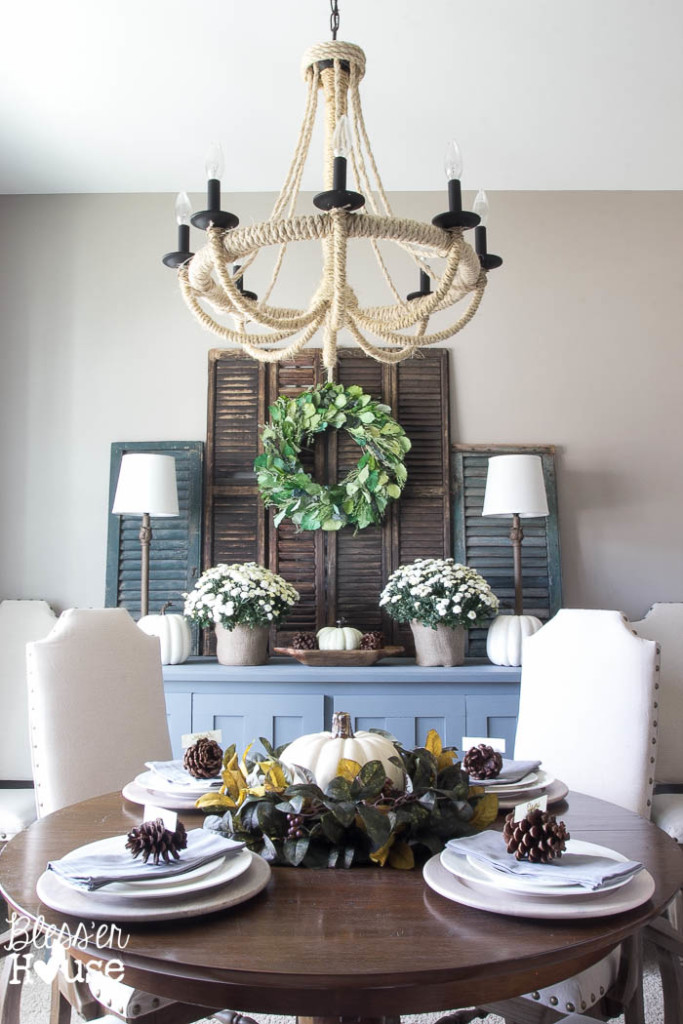 Farmhouse dining room - love the old shutters and the DIY rope chandelier