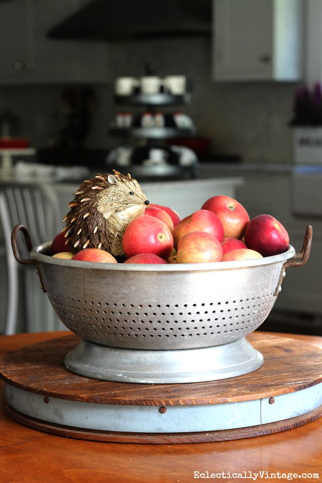 Vintage colander holds apples and a cute little hedgehog for fall kellyelko.com