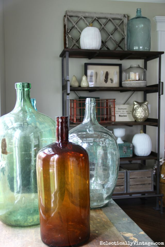 Vintage demijohn look beautiful near a window kellyelko.com