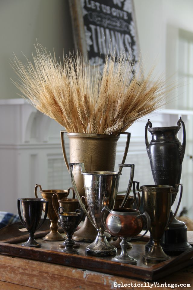 Vintage trophies filled with wheat for fall kellyelko.com
