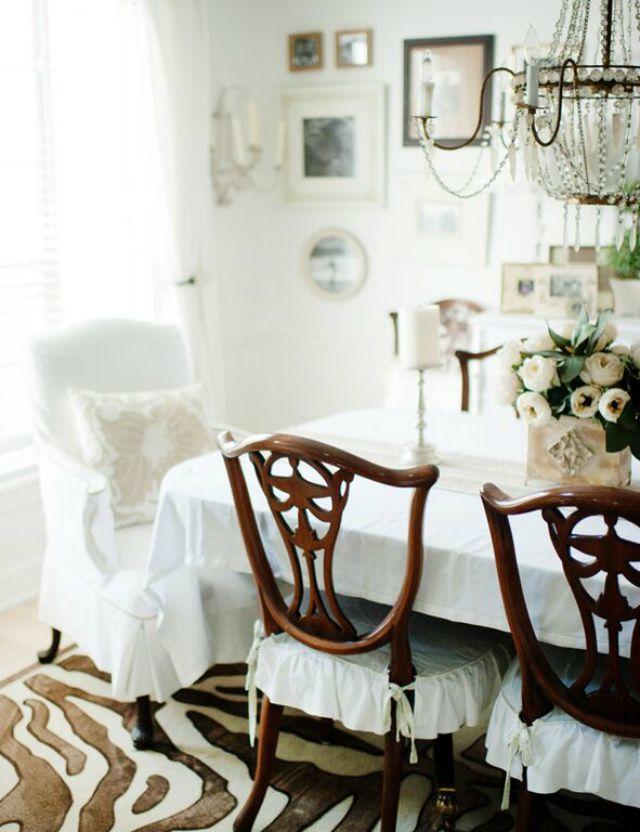 White dining room with zebra rug kellyelko.com