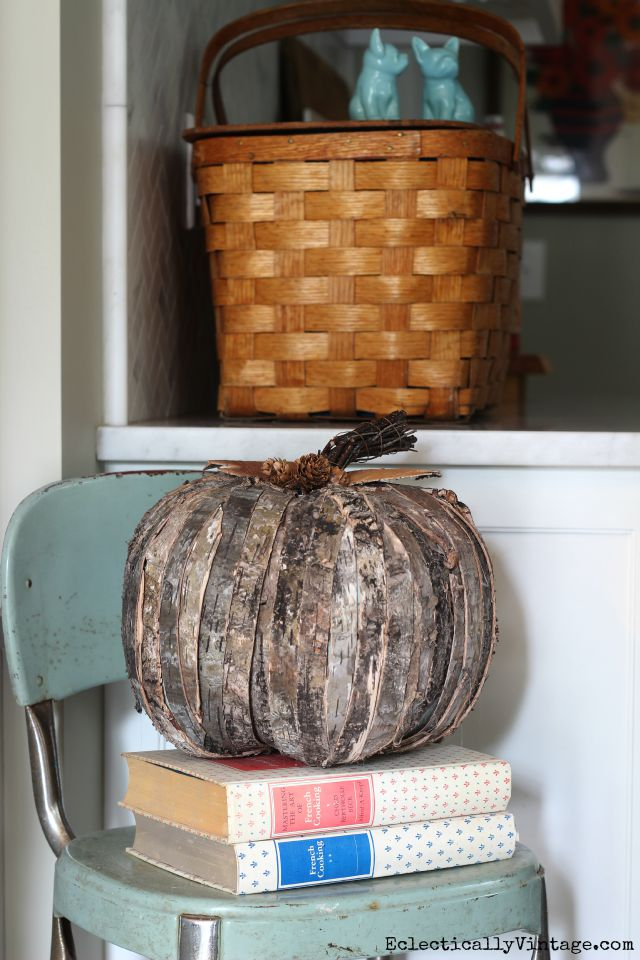 Wood bark pumpkin - so cute on a stack of vintage cookbooks kellyelko.com