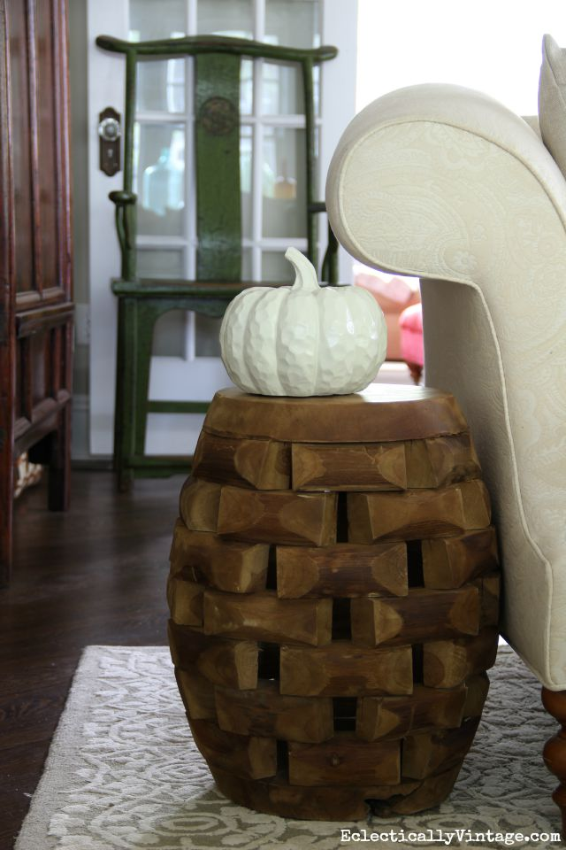 Love this little wood garden stool as an accent table kellyelko.com