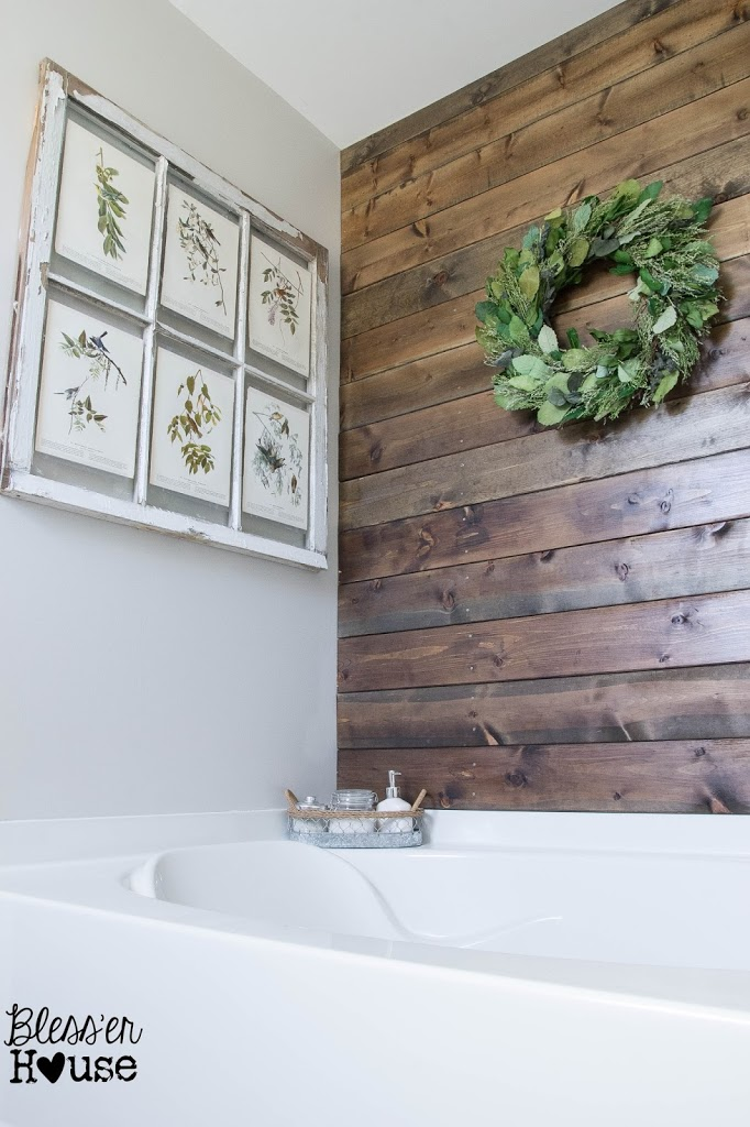 Wood plank bathroom wall really warms up the room