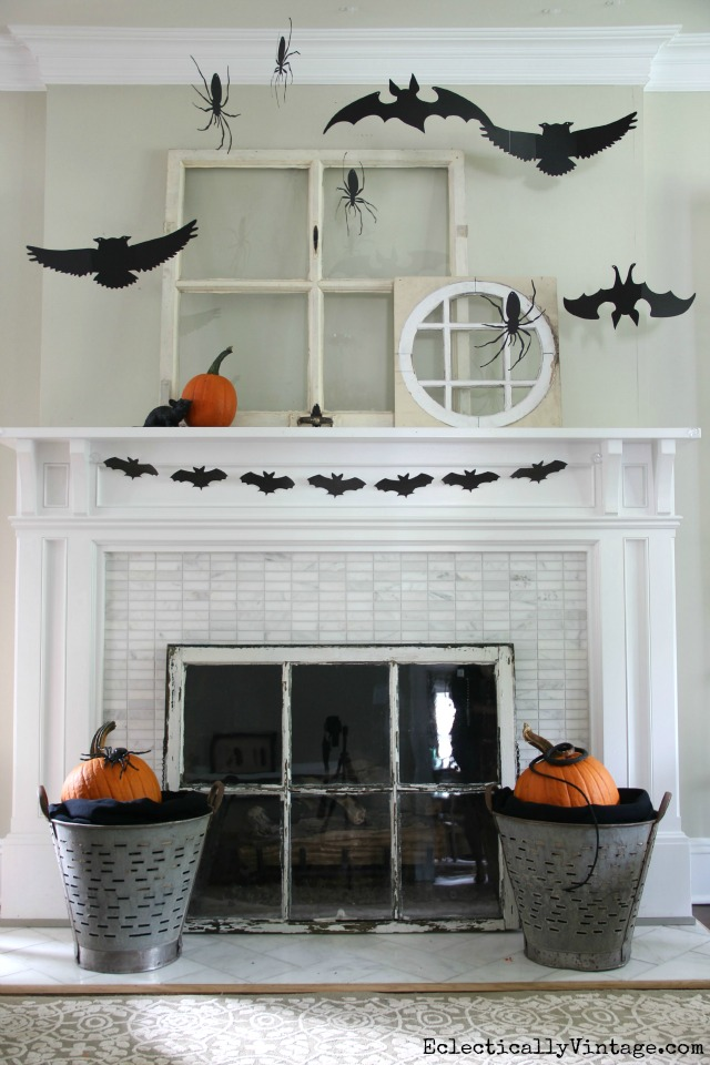 Love this silhouette Halloween mantel with vintage windows and the DIY bat banner printable kellyelko.com
