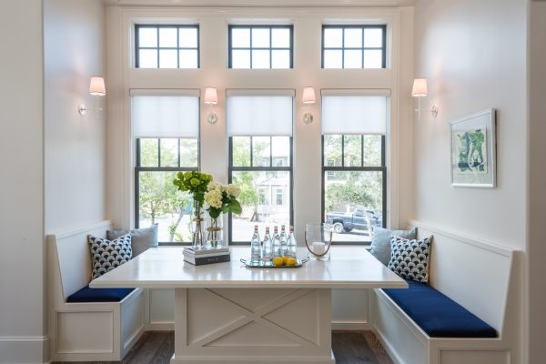Love the built in banquette - take the full tour of this beautiful coastal home kellyelko.com